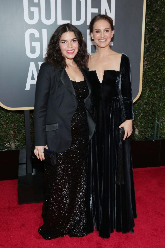 <p>America Ferrera, who is expecting her first child with her husband, Ryan Piers Williams, and Natalie Portman attend the 75th Annual Golden Globe Awards at the Beverly Hilton Hotel in Beverly Hills, Calif., on Jan. 7, 2018. (Photo: Steve Granitz/WireImage) </p>