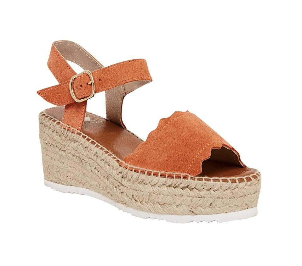 <p>The scalloped toe strap detail of this <span>André Assous Cacia Platform Wedge Sandal</span> ($113, originally $189) adds a decorative touch.</p>