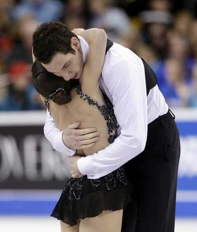 Marissa Castelli and Simon Shnapir hug after skating during the pairs free skate at the U.S. Figure Skating Championships Saturday, Jan. 11, 2014 in Boston. (AP Photo/Steven Senne)