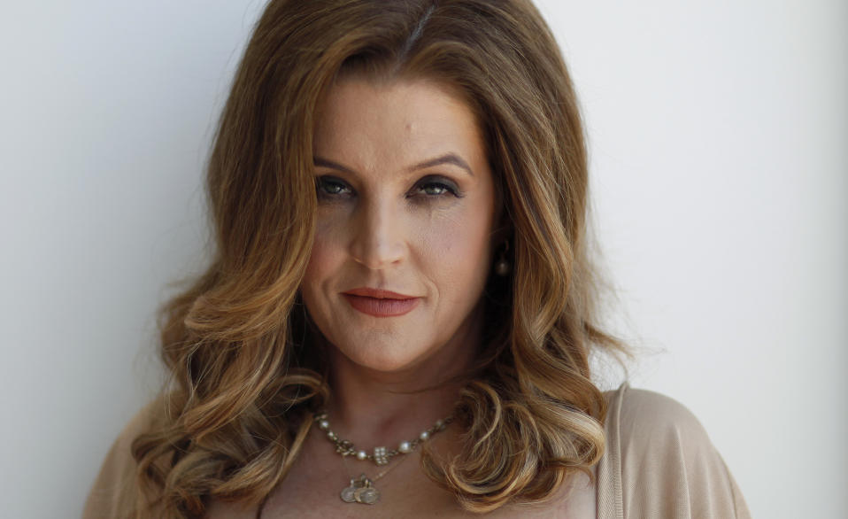 "Music recording artist Lisa Marie Presley poses for a portrait in West Hollywood, California May 10, 2012.  Presley, who grew up between her father's estate, Graceland, in Memphis, Tennessee and Beverly Hills, California, found her voice away from American soil in the green suburban county of Sussex in England. Her new album ""Storm and Grace,"" which harks to Presley's country rock roots, came to life at the hands of British producers and Grammy-winning country musician T-Bone Burnett in London. Picture taken May 10, 2012. REUTERS/Mario Anzuoni  (UNITED STATES - Tags: ENTERTAINMENT PROFILE HEADSHOT)"