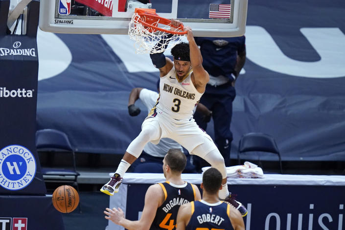 New Orleans Pelicans guard Josh Hart (3) slam-dunks over Utah Jazz center Rudy Gobert and forward Bojan Bogdanovic in the final seconds of the second half of an NBA basketball game in New Orleans, Monday, March 1, 2021. (AP Photo/Gerald Herbert)