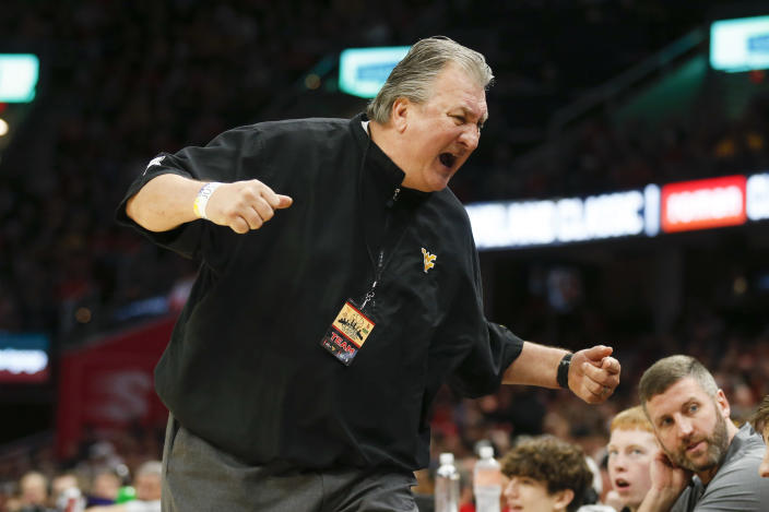 West Virginia head coach Bob Huggins reacts to a play against Ohio State during the second half of an NCAA college basketball game Sunday, Dec. 29, 2019, in Cleveland. West Virginia defeated Ohio State 67-59. (AP Photo/Ron Schwane)