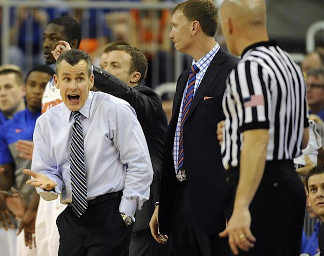Florida coach Billy Donovan, left, has words with an official during the first half of an NCAA college basketball game against Missouri Tuesday, Feb. 4, 2014 in Gainesville, Fla. Florida took the game win 68-58. (AP Photo/Phil Sandlin)