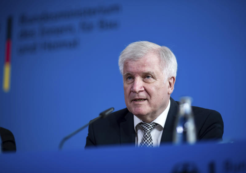 German Interior Minister Horst Seehofer speaks during a press conference in Berlin, Germany, Tuesday, June 18, 2019 on the killing of Walter Luebcke, a long-time member of Chancellor Angela Merkel's center-right Christian Democrats, who was found shot in the head on June 2 at his home near the central German city of Kassel, where he led a regional government office. (Bernd von Jutrczenka/dpa via AP)