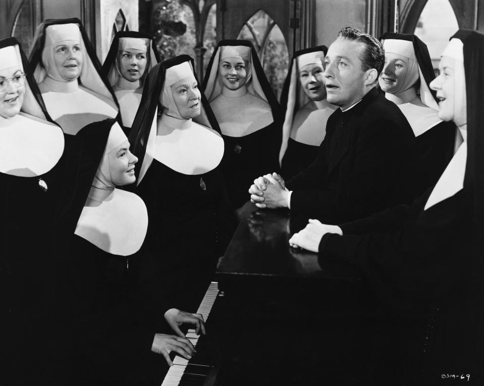 Father Chuck O'Malley (Bing Crosby) sings with Sister Benedict (Ingrid Bergman) and other nuns in a scene from the 1945 film The Bells of St. Mary's. (Photo by �� John Springer Collection/CORBIS/Corbis via Getty Images)