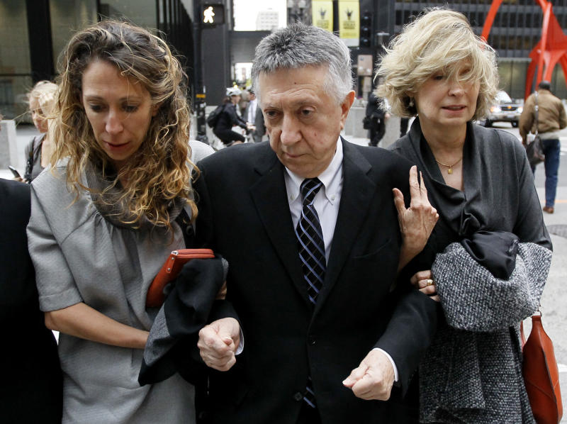 """William Cellini, center, departs the federal courthouse with unidentified family members after Judge James Zagel sentenced him to 366 days in prison and a $75,000 fine Thursday, Oct. 4, 2012, in Chicago. Cellini, 77, was convicted last year for his role in trying to get a $1.5 million campaign contribution for former Gov. Rod Blagojevich from the Oscar-winning producer of """"Million Dollar Baby"""" in exchange for state business.  (AP Photo/Charles Rex Arbogast)"""