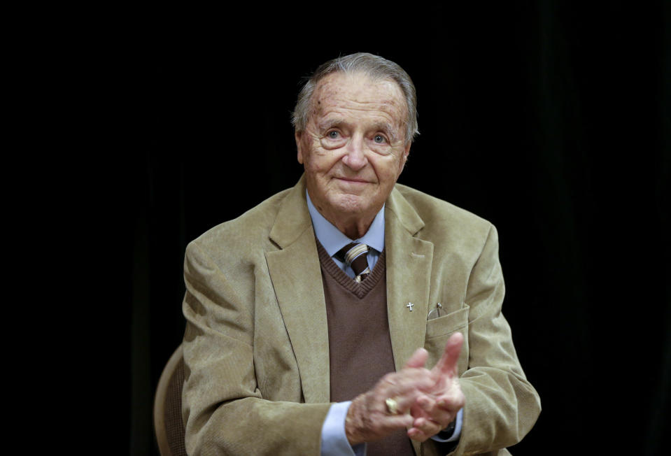 """FILE - In this Wednesday, Jan. 10, 2018, file photo, retired Florida State NCAA college football coach Bobby Bowden applauds following a Rotary Club luncheon in Omaha, Neb. Bowden, hospitalized last week after contracting COVID-19, says he is feeling better and hopes to go home soon. Bowden, 90, told the Tallahassee Democrat on Monday, Oct. 12, 2020,""""I am doing good. I appreciate everyone's thoughts, I really do."""" (AP Photo/Nati Harnik, File)"""