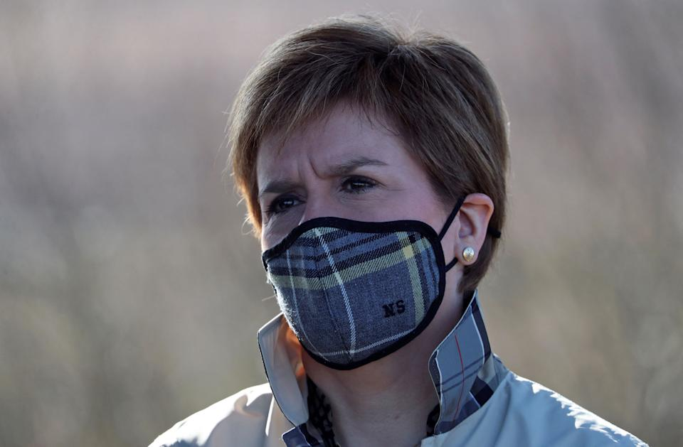 Scotland's First Minister and leader of the Scottish National Party (SNP), Nicola Sturgeon wearing a protective face covering to combat the spread of the coronavirus, during a campaign visit to Whitelee Wind Farm near Eaglesham in Scotland on April 9, 2021, ahead of the upcoming Scottish Parliament election which is to be held on May 6, 2021. (Photo by RUSSELL CHEYNE / POOL / AFP) (Photo by RUSSELL CHEYNE/POOL/AFP via Getty Images)
