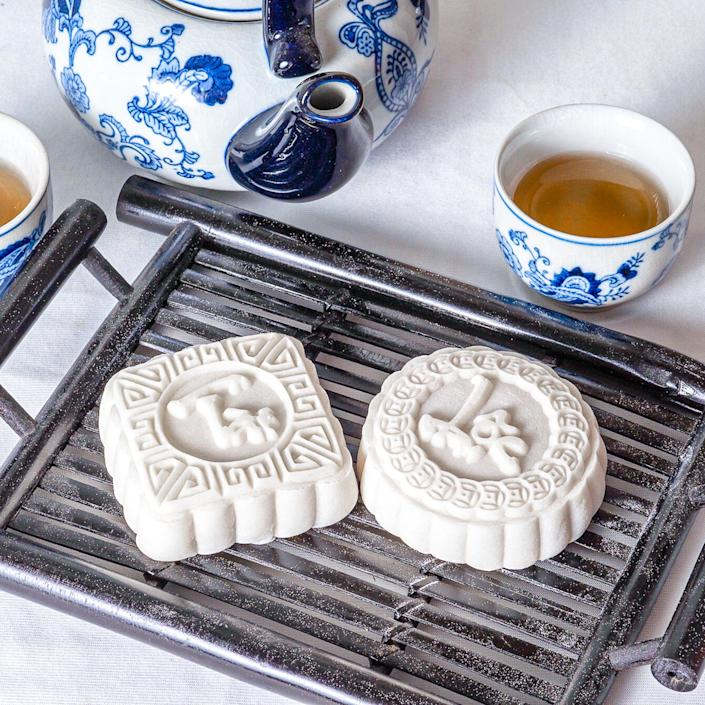 Snow skin mooncakes, like the two pictured, are no-bake pastries. (Courtesy Suzanne Nuyen)