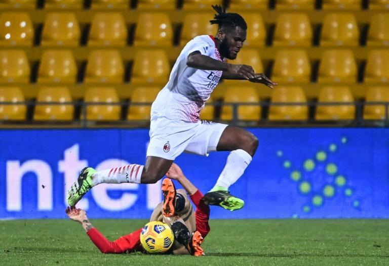AC Milan midfielder Franck Kessie jumps over a Benevento opponent during a 2-0 Serie A victory