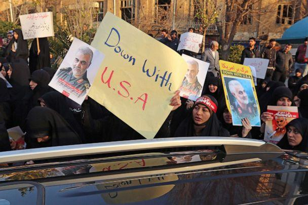 PHOTO: Iranian demonstrators hold placards bearing the image of slain military commander Qassem Soleimani in front of the British embassy in Tehran, Janu. 12, 2020 following the British ambassador's arrest for allegedly attending an illegal demonstration. (Atta Kenare/AFP via Getty Images)