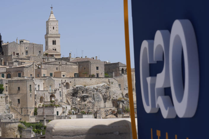 """A view of Matera, Italy, where a G20 foreign affairs ministers' meeting is taking place Tuesday, June 29, 2021. For decades, visually stunning Matera, a provincial capital of Basilicata, one of Italy's poorest regions, had been synonymous with southern European poverty and underdevelopment. Matera's famous """"Sassi"""" — literally stones — were dwellings carved out of natural caves of tuff. In recent years, the """"Sassi"""" have been increasingly converted into boutique hotels, restaurants and getaway homes for the affluent, eager to be inspired by dramatic views from the city, which towers over a torrent. (AP Photo/Antonio Calanni)"""