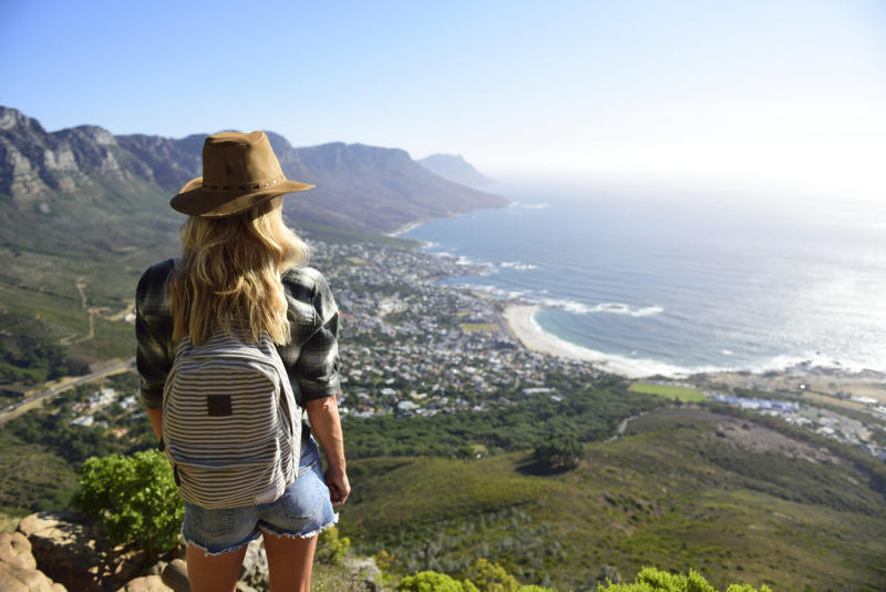A stock image of a woman with a backpack standing overlooking Cape Town, South Africa. A German backpacker has warned people about accepting jobs via Gumtree.