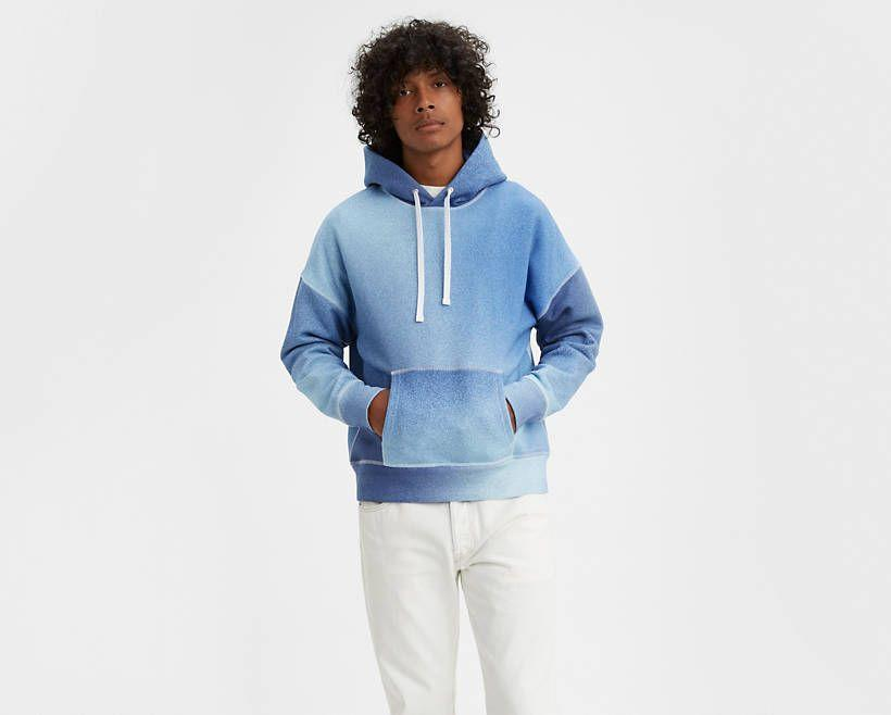 """<p><strong>Levi's Made & Crafted</strong></p><p>levi.com</p><p><strong>$62.49</strong></p><p><a href=""""https://go.redirectingat.com?id=74968X1596630&url=https%3A%2F%2Fwww.levi.com%2FUS%2Fen_US%2Fapparel%2Fclothing%2Ftops%2Fboxed-hoodie%2Fp%2F845810001&sref=https%3A%2F%2Fwww.esquire.com%2Fstyle%2Fmens-fashion%2Fg32945302%2Flevis-summer-sale%2F"""" rel=""""nofollow noopener"""" target=""""_blank"""" data-ylk=""""slk:Buy"""" class=""""link rapid-noclick-resp"""">Buy</a></p><p>A beefy, spray paint-effect sweatshirt courtesy of Levi's Made & Crafted. </p>"""