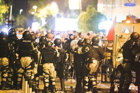 Macedonian riot police block the road near the parliament