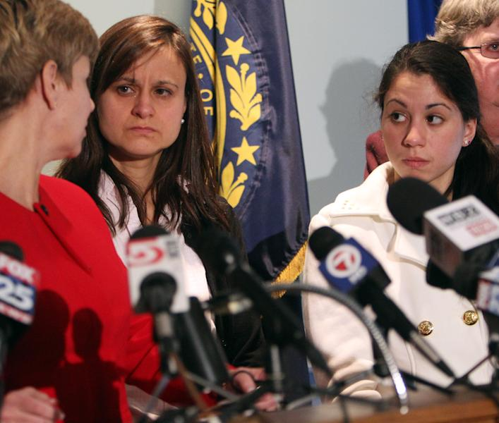 Zenya Hernandez, center, and her daughter, Sarah Hernandez look at Senior Assistant Attorney General Jane Young, during a news conference Friday Dec. 6, 2013 in Concord, N.H. Young said missing teenager Abigail Hernandez wrote a letter to her mother Zenya postmarked Oct. 23 and was received by her mother Nov. 6.(AP Photo/Jim Cole)