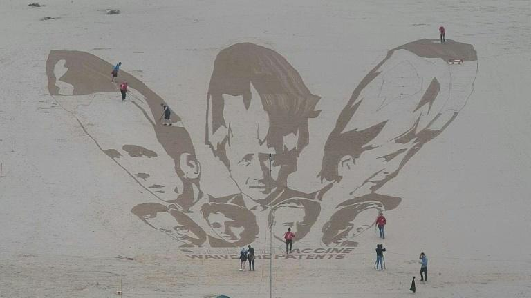 Sand art protest calls for G7 leaders to waive Covid vaccine patents