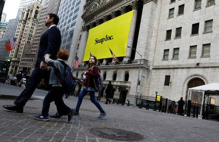 A banner for Snap Inc. hangs on the facade of the New York Stock Exchange (NYSE) on the morning of the company's IPO in New York, U.S., March 2, 2017. REUTERS/Brendan McDermid