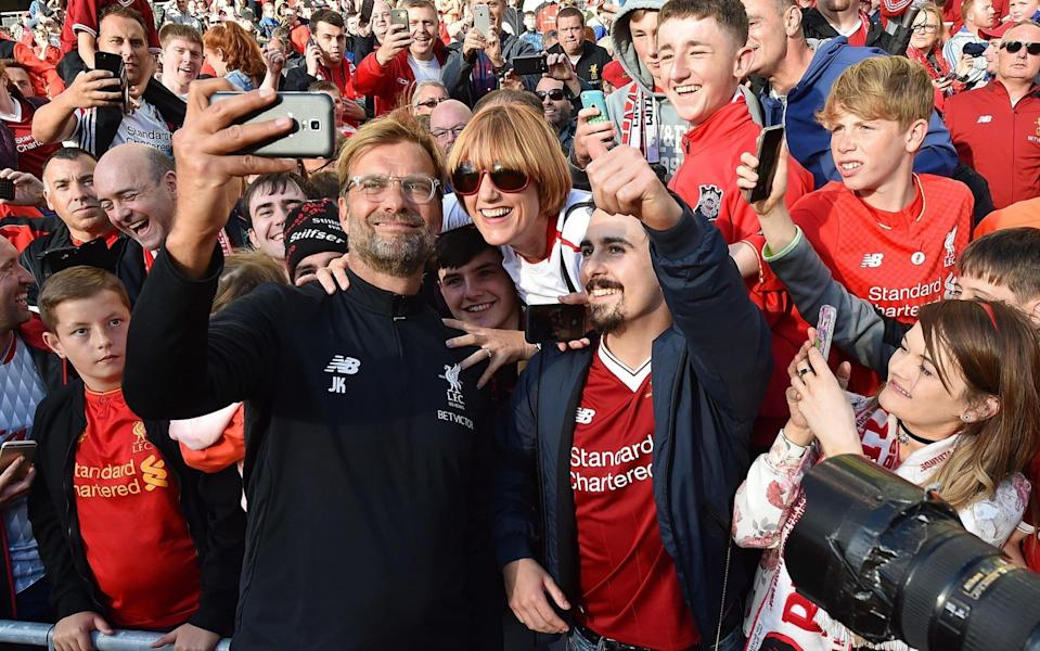Jurgen Klopp has been the apple of Liverpool fans' eyes so far at Anfield, leading the Reds back into the Champions League with his intense pressing style. (The Telegraph)
