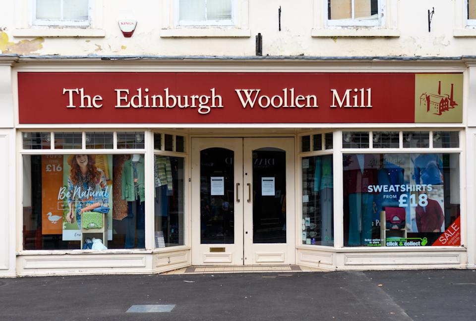 Tiverton, United Kingdom - August 17 2020:  The frontage of Edinburgh Woollen Mill  clothes shop on Fore Street