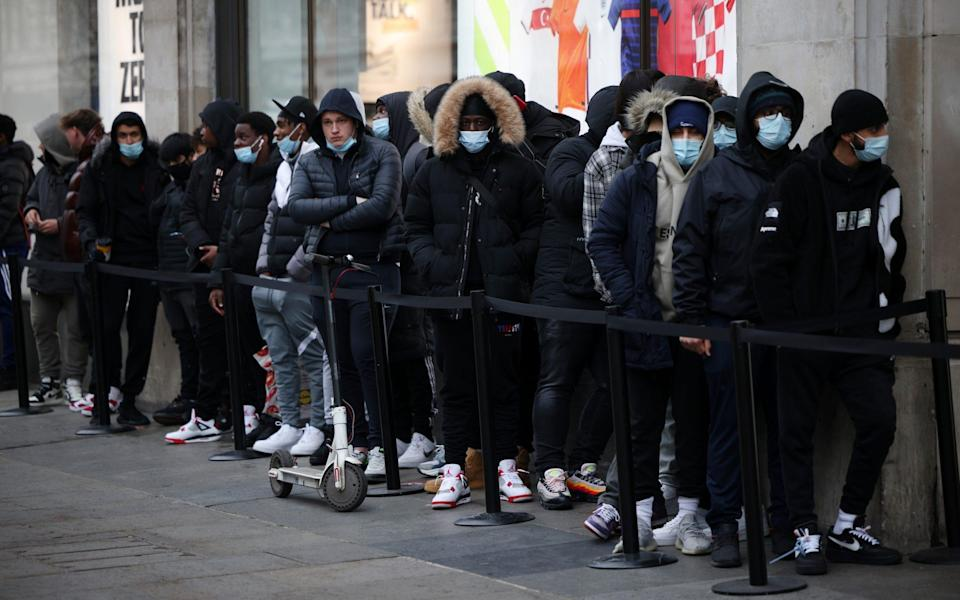 Shoppers queue for the Nike store in London as it reopens after lockdown in April - Dan Kitwood/Getty Images Europe