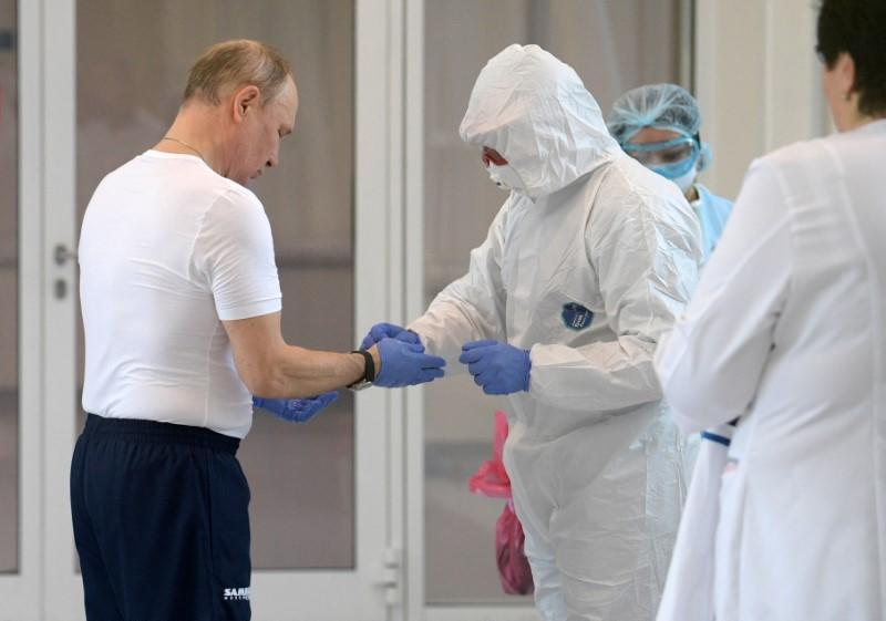Russian President Putin visits a hospital for patients infected with coronavirus disease (COVID-19) on the outskirts of Moscow