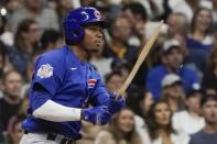 Chicago Cubs' Sergio Alcantara hits a broken bat RBI single during the fourth inning of a baseball game against the Milwaukee Brewers Friday, Sept. 17, 2021, in Milwaukee. (AP Photo/Morry Gash)