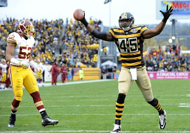 Pittsburgh Steelers tight end Leonard Pope (45) celebrates a touchdown catch as Washington Redskins linebacker Keenan Robinson (52) walks by in the first quarter during an NFL football game on Sunday, Oct. 28, 2012, in Pittsburgh. (AP Photo/Don Wright)