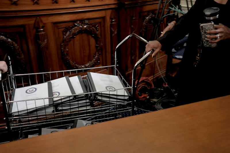 Binders full of notes, testimonies, talking points and more are distributed for Democratic members of Congress at the House Intelligence Committee hearing on the impeachment inquiry, in Washington, D.C., on Nov. 15, 2019. | Gabriella Demczuk for TIME