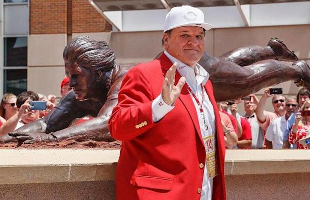 Pete Rose poses with his new bronze statue outside Great American Ballpark. (Reds)