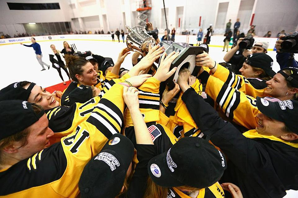 NEWARK, NJ - MARCH 12: The Boston Pride hold up the Isobel Cup after defeating the Buffalo Beauts during Game 2 of the league's inaugural championship series at the New Jersey Devils hockey House on March 12, 2016 in Newark, New Jersey. The Pride defeated the Beauts 3-1. (Photo by Andy Marlin/Getty Images for NWHL)