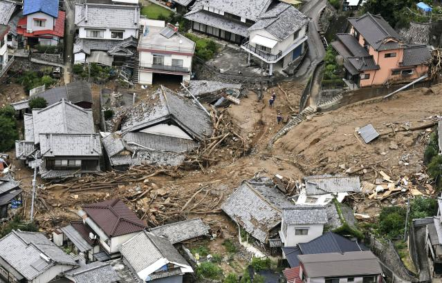<p>Houses are damaged by mudslide following heavy rains in Kure city, Hiroshima prefecture, southwestern Japan, July 7, 2018. Heavy rainfall hammered southern Japan for the third day, prompting new disaster warnings on Kyushu and Shikoku islands Sunday. (Photo: Koji Harada/Kyodo News via AP) </p>