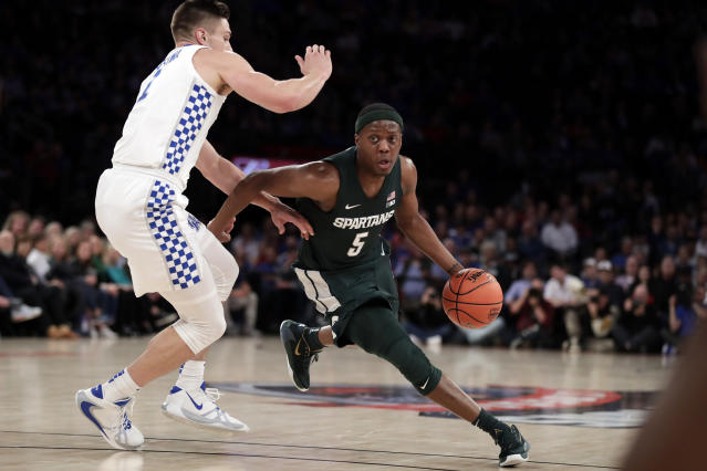 Michigan State guard Cassius Winston (5) drives to the basket past Kentucky forward Nate Sestina (1) during the first half of an NCAA college basketball game Tuesday, Nov. 5, 2019, in New York. (AP Photo/Adam Hunger)