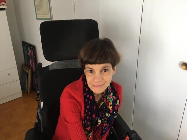 Sandra Gualtieri is disability rights activist with cerebral palsy. She created an airplane seat for people with disabilities in hopes of alleviating some of their travel discomfort. (Submitted by Sandra Gualtieri - image credit)