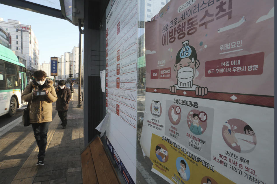 """A poster detailing precautions to take against the coronavirus is seen at a bus station in Goyang, South Korea, Sunday, Feb. 23, 2020. South Korea's president has put the country on its highest alert for infectious diseases and says officials should take """"unprecedented, powerful"""" steps to fight a viral outbreak. The signs read """"Precautions against the coronavirus."""" (AP Photo/Ahn Young-joon)"""