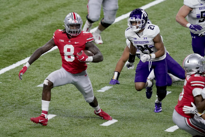 Ohio State running back Trey Sermon (8) runs for the end zone to score past Northwestern defensive back Cameron Mitchell (21) during the second half of the Big Ten championship NCAA college football game, Saturday, Dec. 19, 2020, in Indianapolis. (AP Photo/Darron Cummings)