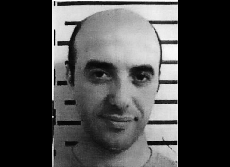 This undated police photo released by Interpol on Monday, April 15, 2013, shows French bandit Redoine Faid. Interpol has joined the hunt for Faid, who escaped from prison after taking four guards hostage and blasting through a series of armored doors to a waiting car. Officials said Faid had a gun and explosives hidden in tissue packets when he escaped on Saturday, April, 13, 2013, from the prison in Lille, near the Belgian border. A prosecutor says he fled in a car, freeing his hostages along the way. (AP Photo/Interpol)