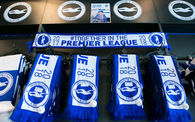 <span>Promotion merchandise is already in the club shop</span> <span>Credit: David McHugh for The Telegraph </span>