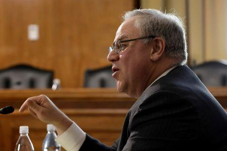 FILE PHOTO: Former energy lobbyist David Bernhardt testifies before a Senate Energy and Natural Resources Committee hearing on his nomination of to be Interior secretary, on Capitol Hill in Washington, U.S., March 28, 2019. REUTERS/Yuri Gripas/File Photo