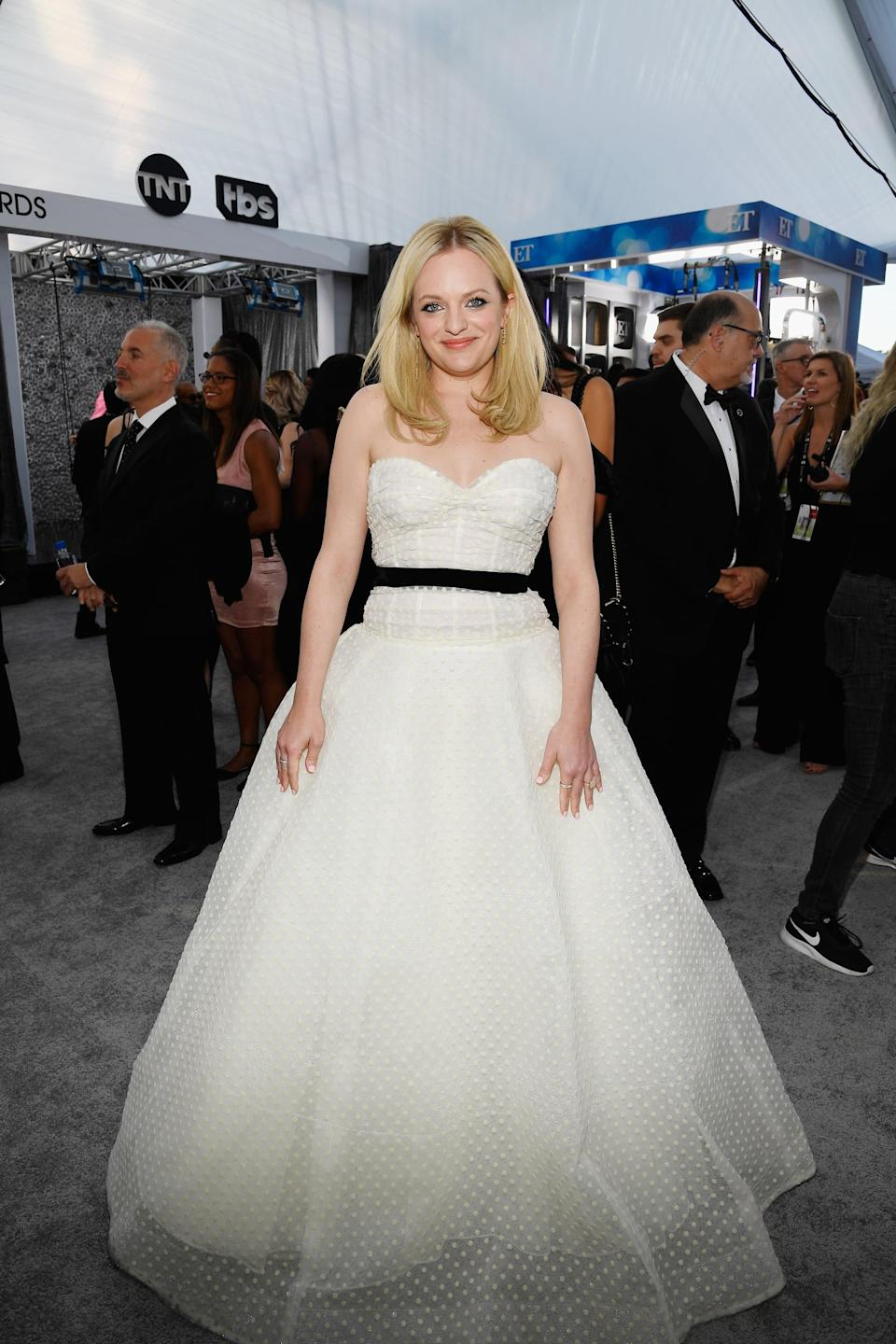 <p>Wearing a Monique Lhuillier gown with Jennifer Meyer and Ofira jewels and Brian Atwood heels.</p>