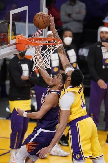 Lakers forward Anthony Davis blocks a shot by Suns guard Devin Booker during Game 3 on May 27, 2021, at Staples Center.