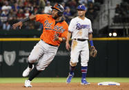 Baltimore Orioles' Maikel Franco rounds second base on a RBI single by Trey Mancini against the Texas Rangers during the eighth inning of a baseball game in Arlington, Texas, Saturday, April 17, 2021. (AP Photo/Ray Carlin)