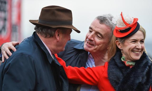 "<span class=""element-image__caption"">Michael and Anita O'Leary congratulate the trainer Noel Meade, left, following their win in the Brown Advisory Plate at Cheltenham. </span> <span class=""element-image__credit"">Photograph: Seb Daly/Sportsfile via Getty</span>"