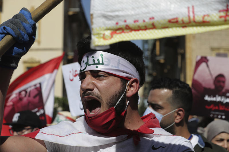 An anti-government protester shouts slogans against the government in Beirut, Lebanon, Saturday, June 13, 2020. Lebanese protesters took to the streets in Beirut and other cities in mostly peaceful gatherings against the government, calling for its resignation as the small country sinks deeper into economic distress. (AP Photo/Hassan Ammar)