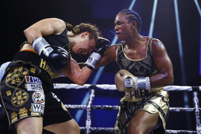 Claressa Shields, right, punches Ivana Habazin during the seventh round of a women's 154-pound title boxing bout in Atlantic City, N.J., Friday, Jan. 10, 2020. (AP Photo/Matt Rourke)