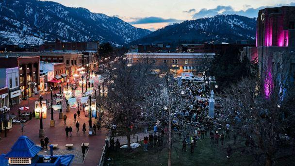 PHOTO: Mourners attend a candlelight vigil outside the Boulder County Courthouse on March 24, 2021 in Boulder, Colo., a few days after a mass shooting at a grocery store that left ten people dead.  (Michael Ciaglo/Getty Images)