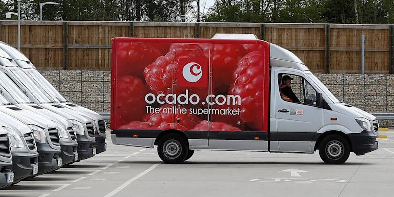 Delivery vans are lined up prior to dispatch at the Ocado CFC (Customer Fulfilment Centre) in Andover, Britain May 1, 2018. Picture taken May 1, 2018.