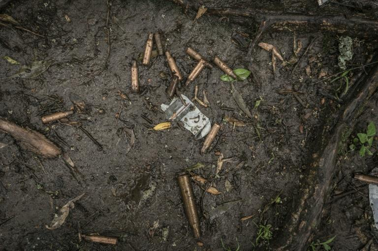 Spent bullet casings litter the ground near a mass grave in Chenna (AFP/Amanuel Sileshi)