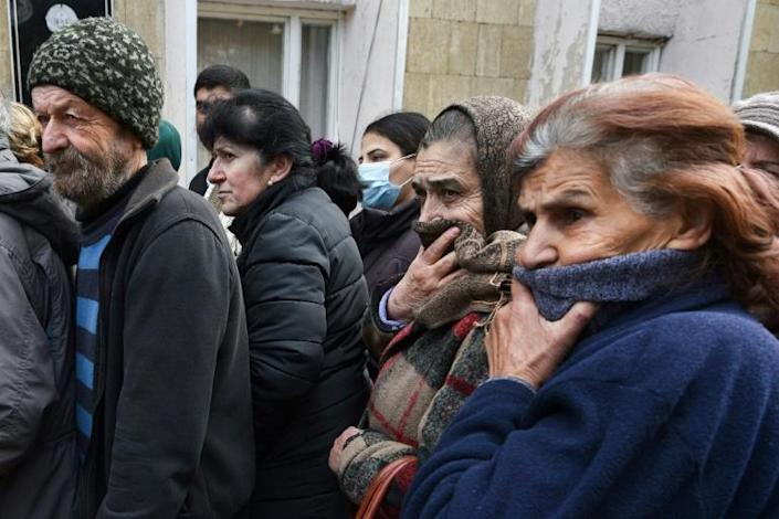 People queue for a food package in Karabakh's main city Stepanakert
