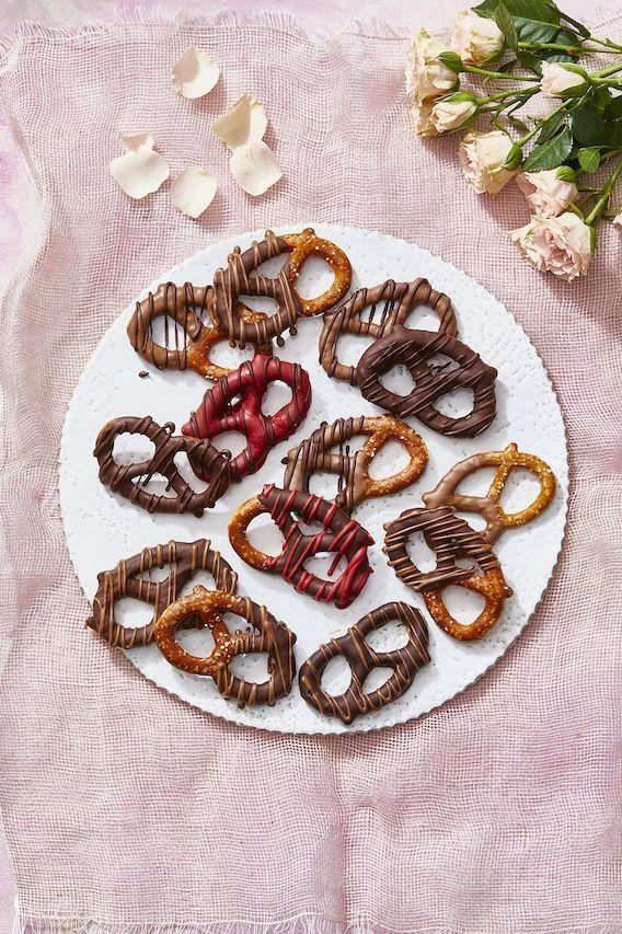 """<p>Behold: the easiest Valentine's Day dessert that everyone wants with their bouquet of roses.</p><p><em><a href=""""https://www.goodhousekeeping.com/food-recipes/a29684957/chocolate-covered-pretzels-recipe/"""" rel=""""nofollow noopener"""" target=""""_blank"""" data-ylk=""""slk:Get the recipe for Chocolate-Covered Pretzels »"""" class=""""link rapid-noclick-resp"""">Get the recipe for Chocolate-Covered Pretzels »</a></em></p>"""